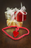 Heart braid and gifts — Stock Photo