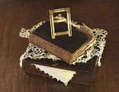 Old photo frame and book on box — Stock Photo