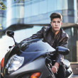 Young man riding a motorbike — Stock Photo