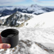 Hot cup of tea on mountain top in winter — Stock Photo