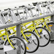 Stock Photo: Yellow bicycles for public transport