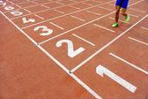 Athlete cross the finish line — Stock Photo