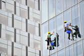 Window washers working on office building — Stock Photo