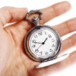 Hand holding old pocket watch — Stock Photo