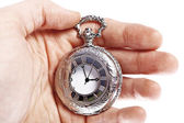 Hand with old pocket watch — Photo