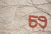 Old street number — Stock Photo