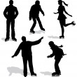 Ice skating silhouettes — Stock Vector