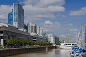 Office buildings and sailboats in harbor of Puerto Madero in Bue — Stock Photo