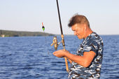 Man with a fishing rod — Stock Photo