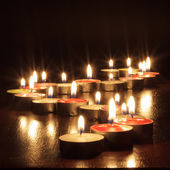 Photograph of candles on black background — Stock Photo