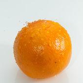 Water drops on orange — Stock Photo