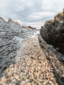 Strata of the earth on the beach — Stock Photo