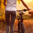 Girls push bike — Stock Photo