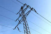 Power line tower against blue sky — Stock Photo