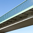 Pedestrian bridge against blue sky — Stock Photo