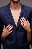Man in suit and woman's hands with red manicure — Stock Photo