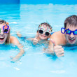 Happy family in water-pool. Happy girl, smile, family, cute, funny, day, swimming-pool, happy birthday, man, women, boy, girl, aqua park, holiday, amazing, colored glasses, joy, toy, sport, health, бассейн, семья, ребенок, вода, счастье, выходной — Stock Photo