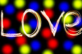 Word Love on color background — Stock Photo