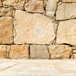 Yellow stone wall and floor background — Stock Photo