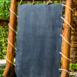 Stock Photo: Empty black board (menu board) at restaurant - nice backgroud