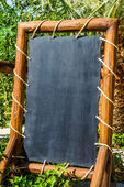 Empty black board (menu board) at a restaurant - nice backgroud — Stock Photo