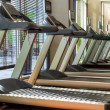 Treadmill machines in gym — Stock Photo