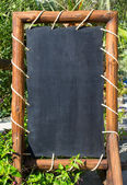 Empty blackboard (menu board) at a reastaurant — Stockfoto