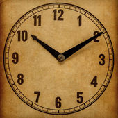 Textured old paper clock face showing 10:10 — Stock Photo