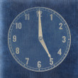 Textured old paper clock face showing 5 o'clock — Stock Photo #40498785