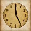 Textured old paper clock face showing 5 o'clock — Stock Photo #40498789