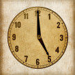 Textured old paper clock face showing 5 o'clock — Stock Photo #40498797