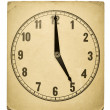 Textured old paper clock face showing 5 o'clock — Stock Photo #40498821