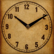 Stock Photo: Textured old paper clock face showing 5 o'clock