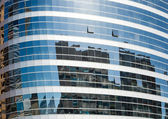 Buildings reflected in windows of office building  — Stock Photo