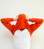 Funny portrait of man in sweater on head against white wall — Stock Photo