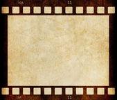 Beige vuile film strip frame achtergrond — Stockfoto