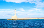 Sunny lighthouse in Mediterranean sea, Crete, Greece — Stock Photo