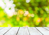 Empty wooden and green summer bokeh background — Stok fotoğraf