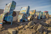 Street art on vintage cars buried in the ground — Foto de Stock