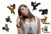 Beautiful sexy professional tattoo master with machines in hand and old machines around — Stock Photo