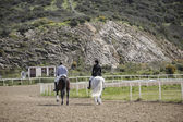Two riders walk on horseback along a nice scenery, Spain — Zdjęcie stockowe
