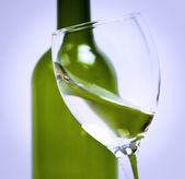 Moving a glass of white wine to be sniffed — Stock Photo