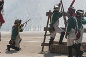 French soldiers at the barricades by firing at the enemy — Stock Photo