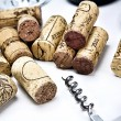 Closeup of a group of wine corks and a corkscrew — Stock Photo