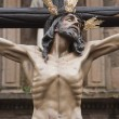 Stock Photo: Figure of Jesus on cross carved in wood by sculptor Gabino AmayGuerrero