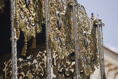 Detail of one side of a pallium embroidery in a throne during a procession of holy week — Stock Photo