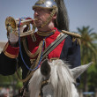 Stock Photo: Musicitrumpeter on horseback, Holy week in Seville province, Andalusia, Spain