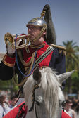 Musician trumpeter on horseback, Holy week in Seville province, Andalusia, Spain — Stock fotografie