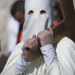 Penitent carried a wooden cross in a procession of Holy week — Stock Photo #34415635