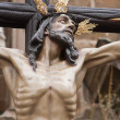 Figure of Jesus on the cross carved in wood — Stock Photo